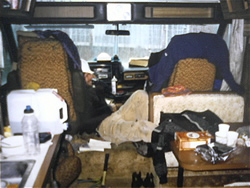 Me on the cell phone in Dick Metcalf's donated motor home at Highland Park Elementary in Seattle - Click for a larger image